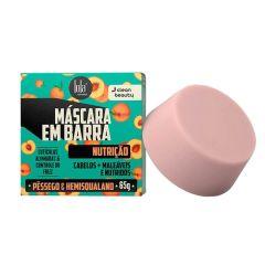 fundo branco, com uma caixinha de máscara e barra lola na cor azul, com desenhos de pêssego. ao lado uma barra de máscara na cor rosada